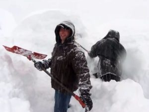 clearing snow from chalet